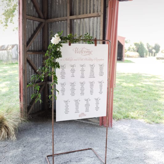 hanging sign board on copper frame in old barn