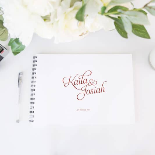 guestbook with red text and black spine