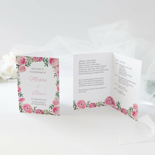 order of service printed onto folded card with pink floral print