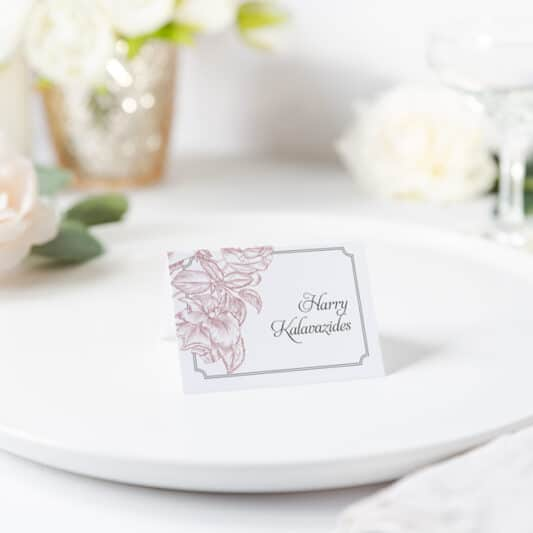 Roses drawn in pink printed on white card sitting on plate