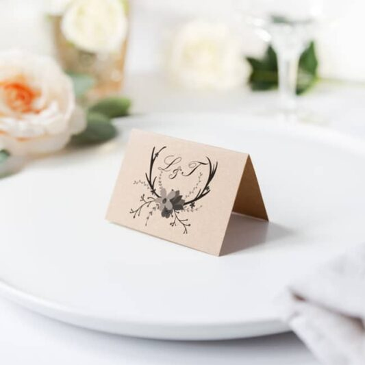 Reverse design of brown folded place card sitting on plate