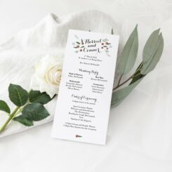watercolor roses long shaped order of service sitting against flowers