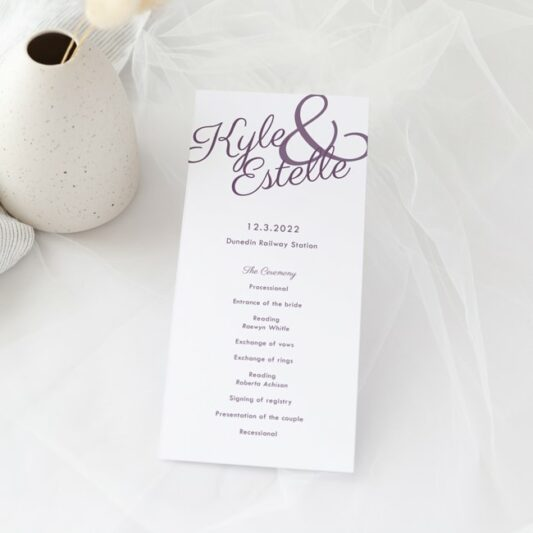 Ampersand with purple bride groom names printed on long order of service
