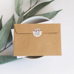 sticker on back of kraft envelope