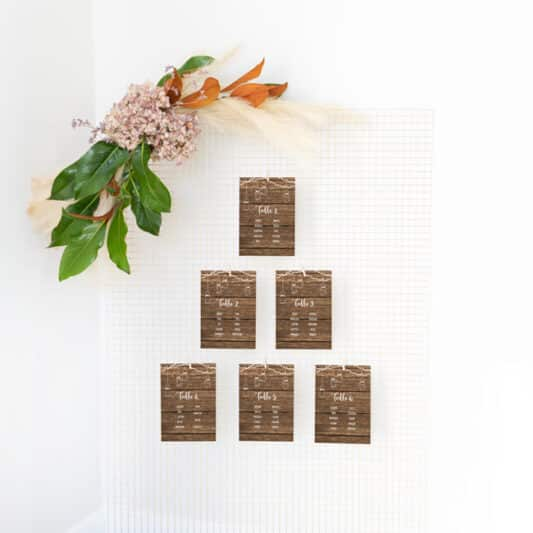 multiple small seating plan cards on wire mesh