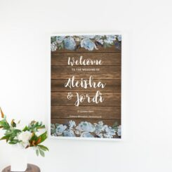 poster in white frame next to flowers in vase