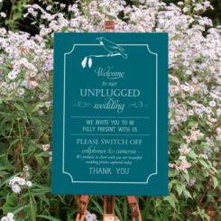 canvas sign on wooden easel in gardens