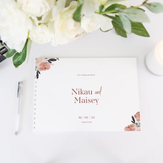 peonies guestbook on white paper with black spiral bound spine