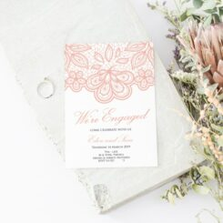 we're engaged printed under pink lace on white card
