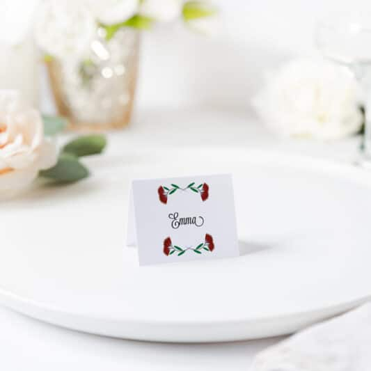 placecard folded sitting on plate printed with Pohutukawa red flowers