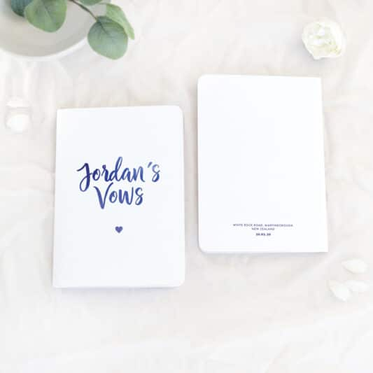 jordan's vows printed on front and wedding venue, date and time printed on back of vow book
