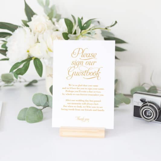 gold sign with long welcome text in a stand