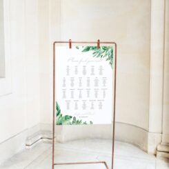 sign board hanging from copper stand