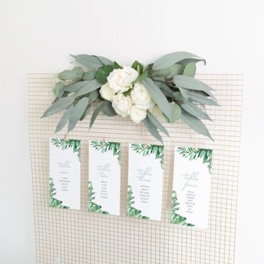 4 cards clipped to gold wire mesh