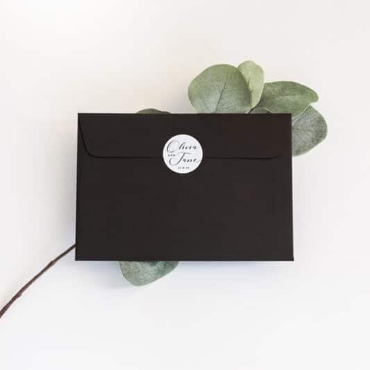 sticker on back of black envelope